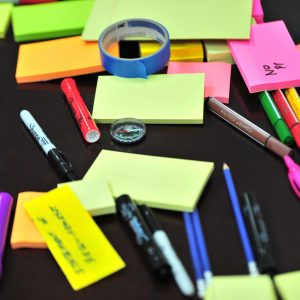 table with sticky notes and colour pens for training development