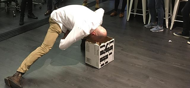 Man playing the box energiser activity