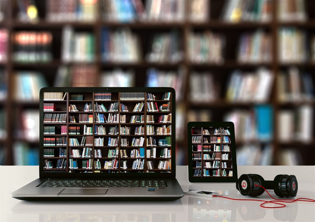 Laptop with books on the screen