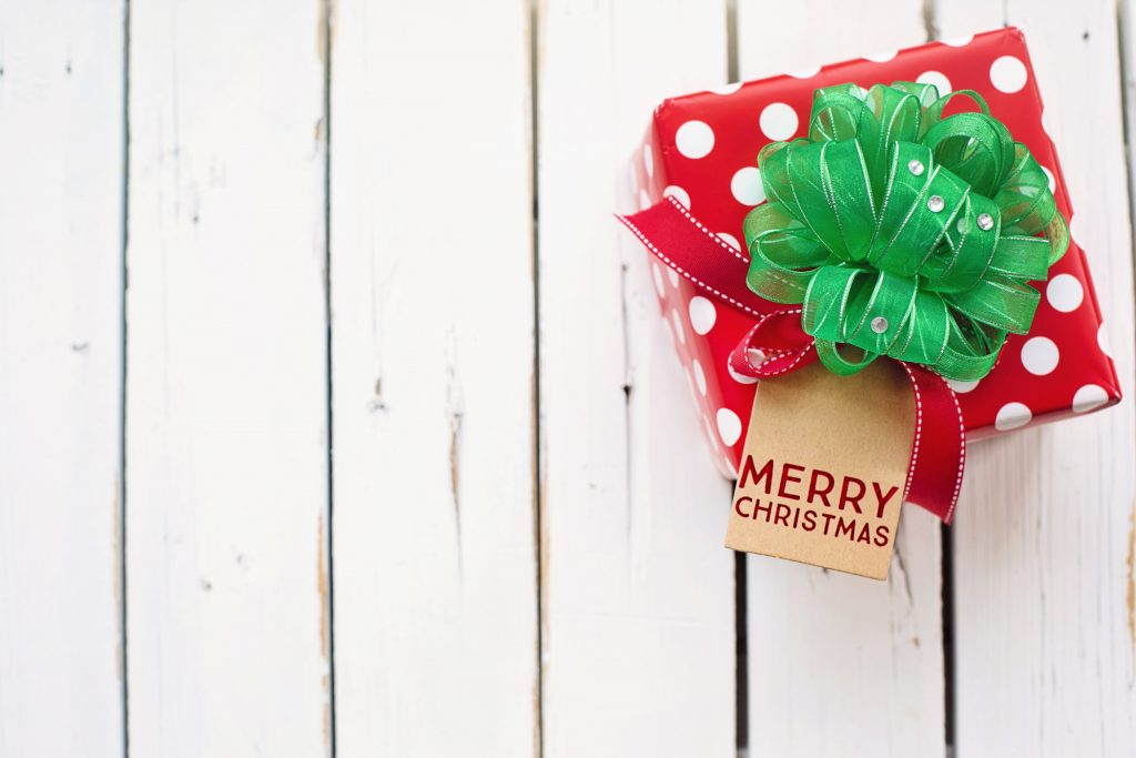 gift wrapped in red and white paper with green ribbon