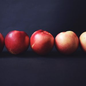 Sequence of five nectarines in different colours